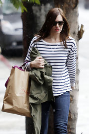 Mandy Moore made her way through the rain in a classic nautical-striped top and cuffed jeans.