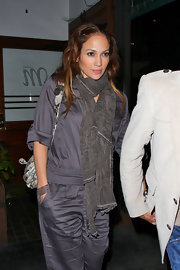 Jennifer bundled up in a soft dark gray pashmina over a satin jumpsuit.