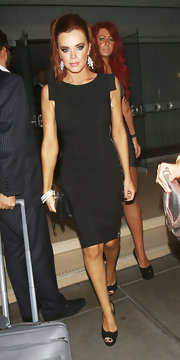 Maria Fowler traded in her ultra-sexy duds for this minimalist-chic LBD while enjoying a night out.