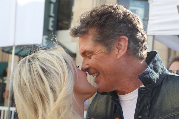 """International star David Hasselhoff and his girlfriend Hayley Roberts make an appearance on the hit talk show """"Extra"""" in Los Angeles"""