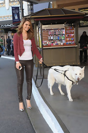 Maria Menounos looked great in chocolate brown, metallic skinny pants while walking her dog to the set of 'Extra.'