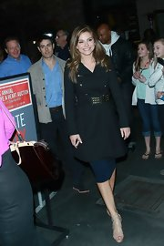 Maria Menounos sported a classic black wool coat with a funky gold, studded belt while out at a charity event in LA.
