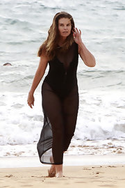 Maria Shriver, sporting a sheer, ankle-length cover-up, hit the beach with her family in Hawaii.
