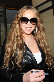 Mariah Carey looks all Hollywood in these butterfly sunglasses.