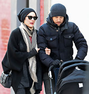 Marion Cotillard added a posh tough to her eclectic streetwear with a quilted Dior bag.