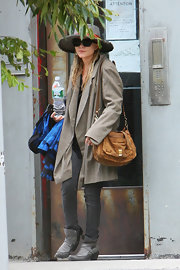 Mary-Kate Olsen showed off her leather shoulder bag while hiding out in downtown Manhattan.