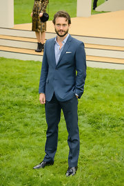 Hugh Dancy showed off his sleek and sophisticated style with this two-button suit.