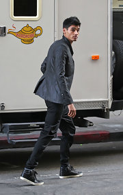 Siva Kaneswaran's leather sneakers upgraded his blazer and jean combo to a style star status.
