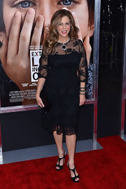 Rita Wilson gave her sophisticated lace dress a sultry finish with black strappy sandals.