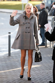 Amanda Holden waved to fans as she arrived at Glasgow's Clyde Auditorium for 'Britain's Got Talent' auditions in a stylish plaid swing coat.