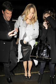 Kate dons a soft ray fur coat over her leather mini for a night out on the town.