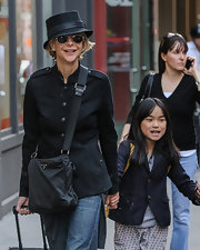 Meg Ryan sported a fitted military-inspired jacket with leather epaulets and a cinched waist.