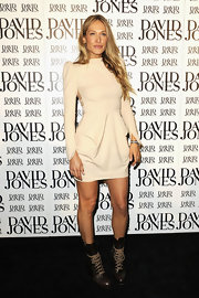 Erika Heynatz paired her lace up boots with a nude draped dress.