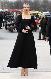 Ulyanna Sergeenko looked elegant in a long black dress with scalloped neckline and hem.
