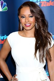 Mel B went for high drama by sweeping her waves to one side for a glamorous and seductive look.
