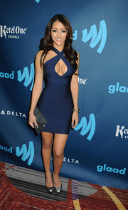 Melanie Iglesias opted for a figure-hugging bandage dress with an over-sized keyhole cutout for her red carpet look at the GLAAD media awards.