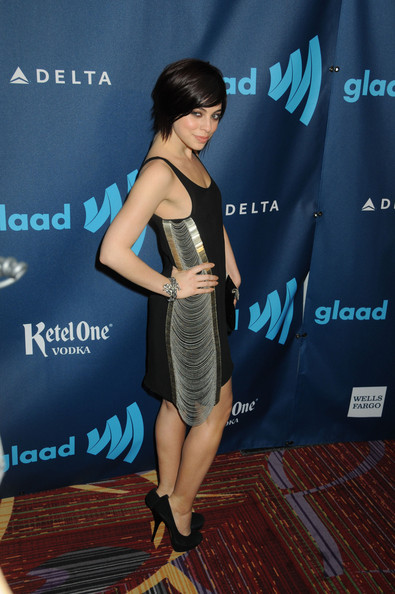 Krysta Rodriquez opted for a more modern take on the cocktail dress with this basic dress with silver chain embellishments.