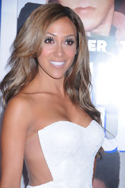 Melissa Gorga's loose waves showed off her honey locks beautifully.