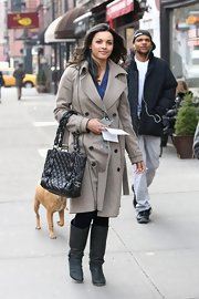 Jessica Lucas wore a long double-breasted wool coat while filming 'Are We Officially Dating?' in NYC.