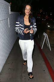 Michelle Rodriguez looked relaxed in black thong sandals and baggy pants during a night out at Chateau Marmont.