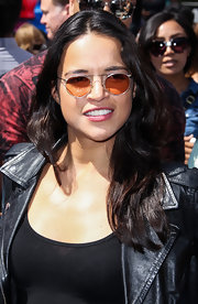 Michelle Rodriguez accessorized with a pair of modern round sunglasses at the Turbo-Charged Party in LA.