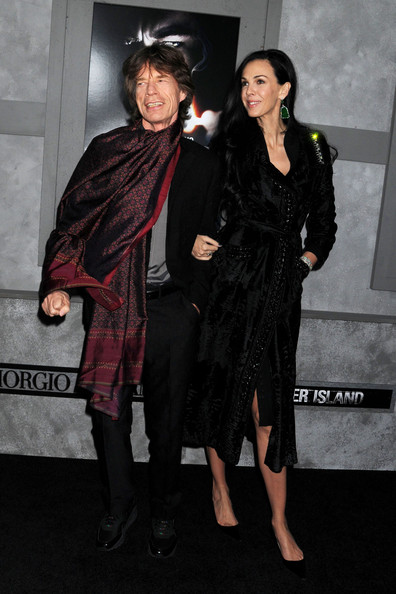 Mick Jagger accessorized his black suit with a luxe jewel-toned scarf, deliberately draped around his neck at a movie premiere in NYC.