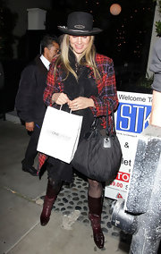 Mira Sorvino looked hip in her wine-colored patent leather boots.