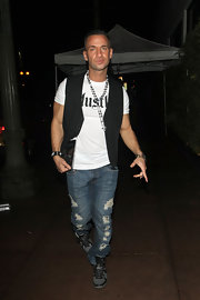 Mike wears gray leather sneakers with black lacing and piping while out in Hollywood.