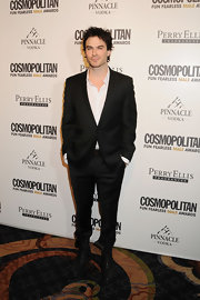Ian looked dapper at the Cosmo Awards in a classic suit sans tie. He mixed up the look with unlaced combat boots.