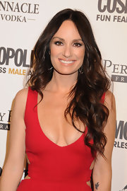 Catt Sadler radiated on the red carpet in a plunging red gown. Soft long curls added the ultimate sex appeal to her look.