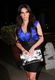 Kim paired her pencil skirt and cobalt blue shirt with a stunning cocktail ring.