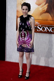 "Brittany rocked a killer pair of ankle strap peep-toes to ""The last Song"" movie premiere. She made an interesting dress choice by donning this abstract print feathered number."