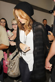 Miley kept warm while traveling through LAX in a knit beanie.