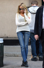 Leticia Cyrus kept it casual with a cream V-neck sweater while out in NYC.