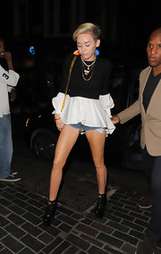 Miley had fun with textures and fabrics when she donned this cotton-trimmed wool-blend sweater top.