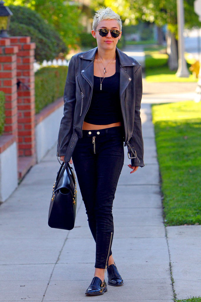 Miley Cyrus rocks a leather jacket and pants as she is spotted out and about in LA. The short haired former Disney star smiled and gave a thumbs up.
