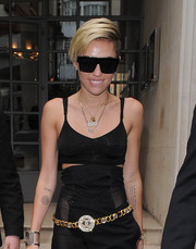 Miley Cyrus stepped out in London wearing bold square shades.