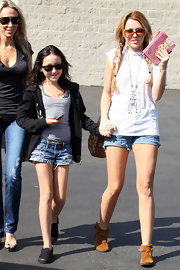 Noah Cyrus strolled in a pair of destroyed denim cut offs while hanging out with sister, Miley Cyrus, who sported a similar pair of short shorts.