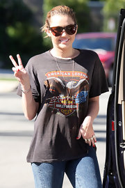 Miley Cyrus showed off her casual side while out and about wearing a Harley Davidson T-shirt.