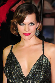 Milla Jovovich's look at 'The Three Muskateers' premiere was the ultimate in sexy. Her smoky eyes were done up with a range of rich jewel tones and plenty of black mascara.