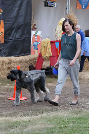 Milla Jovovich kept her shoes subdued with these simple and stylish gray ballet flats.