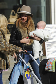 Millie Mackintosh sported a casual walker hat while taking a stroll out with friends in London.