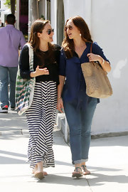 Minka Kelly took a stroll through West Hollywood carrying her needs in an animal print tan shoulder tote.