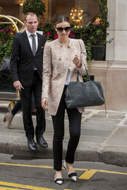 Miranda Kerr stepped out in Paris looking ultra chic in black skinnies and a snakeskin coat.
