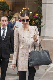 Miranda Kerr looked fiercely chic in a nude snakeskin coat while out shopping in Paris.