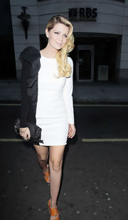 Mischa wears a black and white ruffled cocktail dress while out in London.