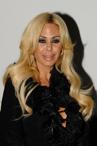 Shauna Sand was flawlessly coiffed in a long wavy style during a night out at Voyeur Club.