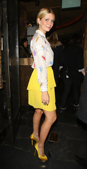 Mischa Barton teamed her sweet nightclub ensemble with yellow satin Dolores platforms.