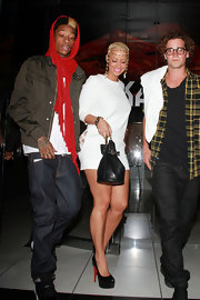 Amber Rose teamed her sultry white mini with black leather platform pumps.