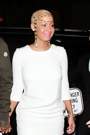 Amber Rose as white hot out in Hollywood last night wearing a bright mini and channeling Cleopatra with her beaded head piece. The model donned pink lips for an added pop of color to her look.